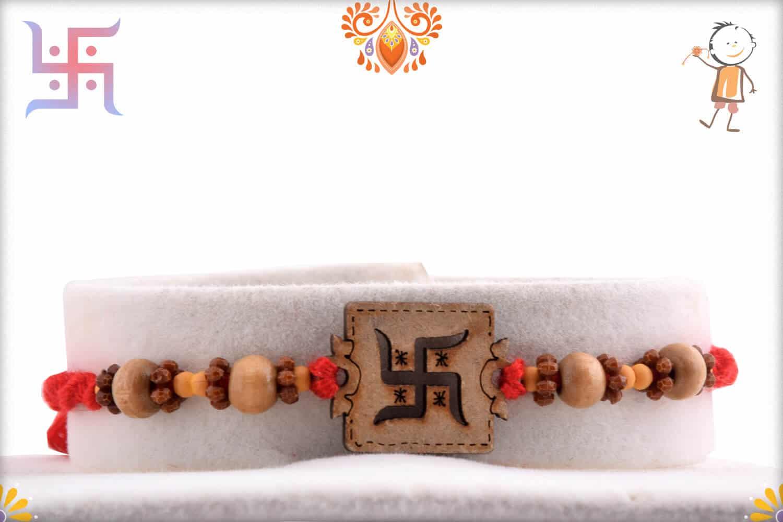 Wood Engraved Swastik Rakhi | Send Rakhi Gifts Online 1