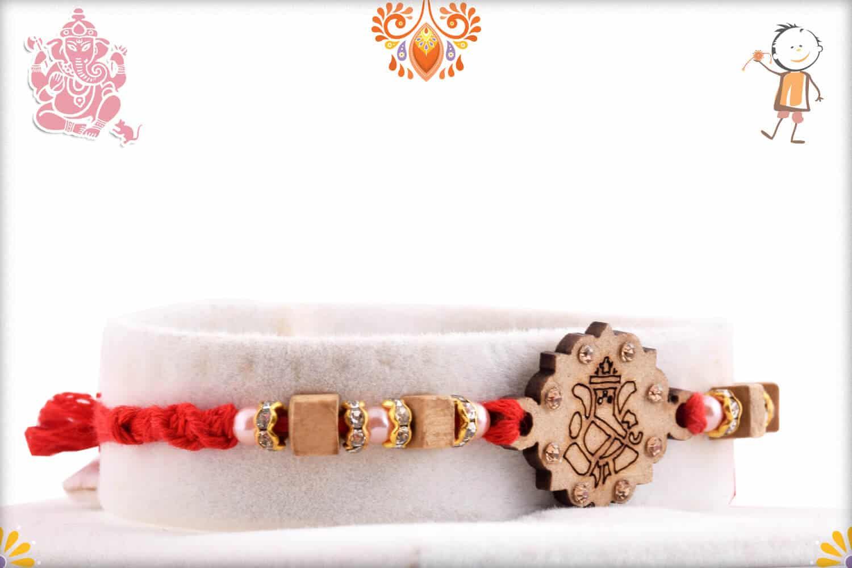 Wood Engraved Ganpati Rakhi with Diamonds   Send Rakhi Gifts Online 2