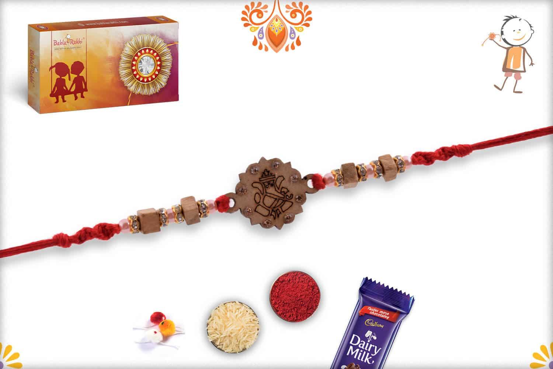 Wood Engraved Ganpati Rakhi with Diamonds   Send Rakhi Gifts Online 3