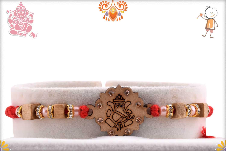 Wood Engraved Ganpati Rakhi with Diamonds   Send Rakhi Gifts Online 1