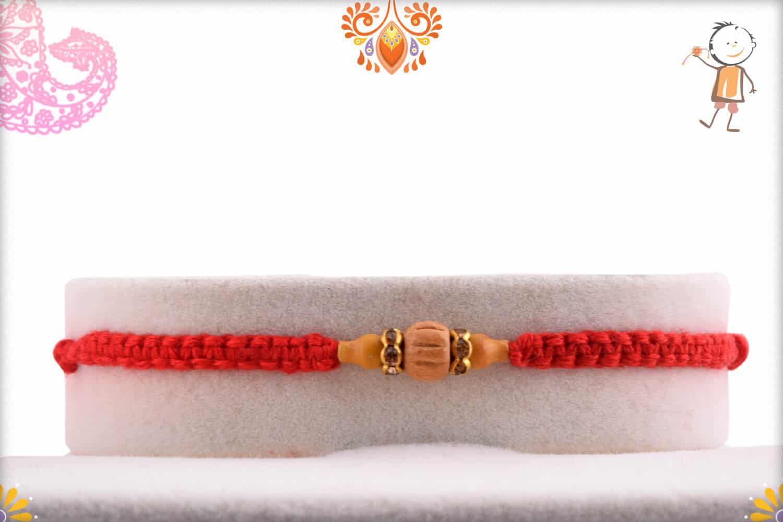 Uniquely Knotted Delicate Sandalwood Rakhi with Diamond | Send Rakhi Gifts Online 1