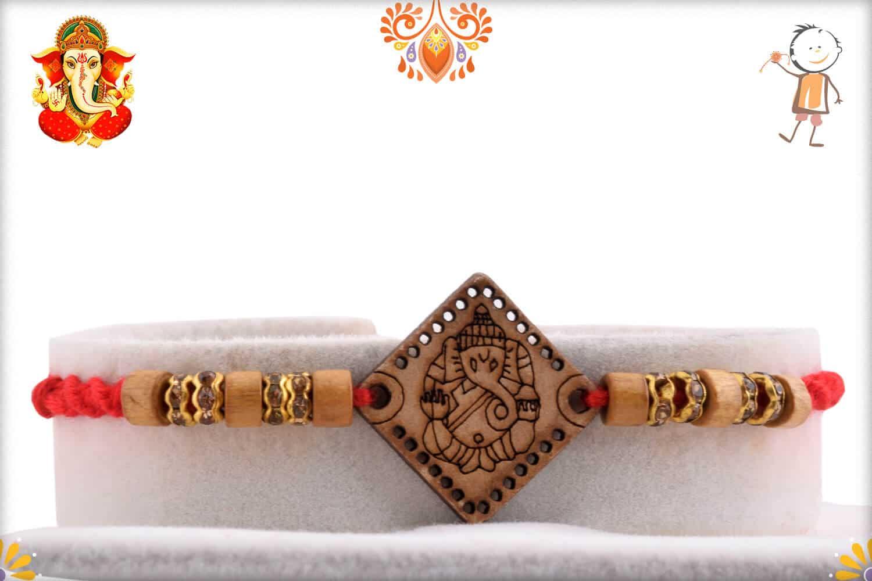Wood Engraved Ganpati Rakhi with Diamond and Sandalwood Beads   Send Rakhi Gifts Online 1