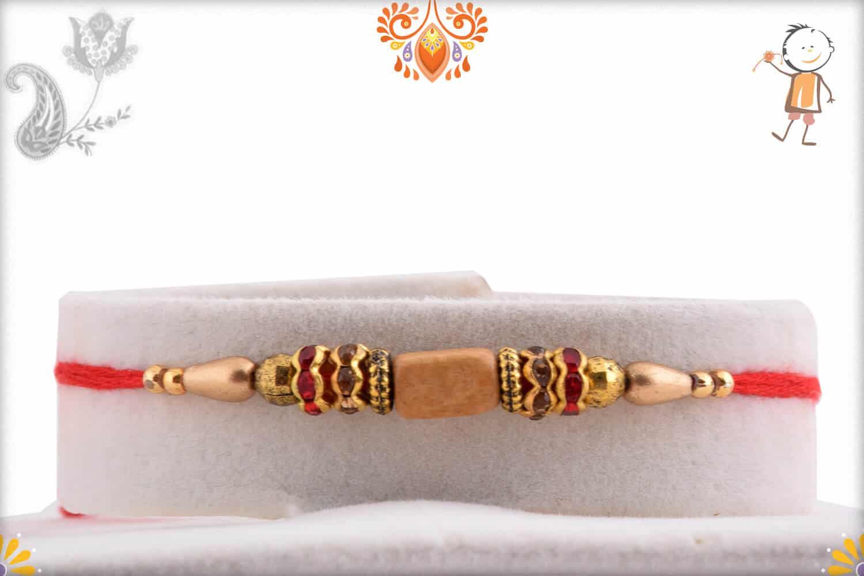 Unique Sandalwood Bead Rakhi with Diamond Rings | Send Rakhi Gifts Online 1