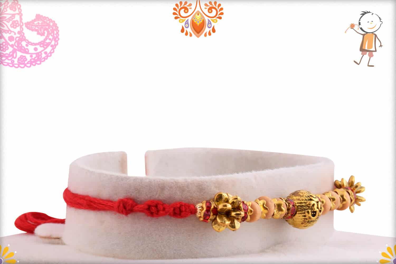 Om Engraved Bead Rakhi with Sandalwood Beads | Send Rakhi Gifts Online 1