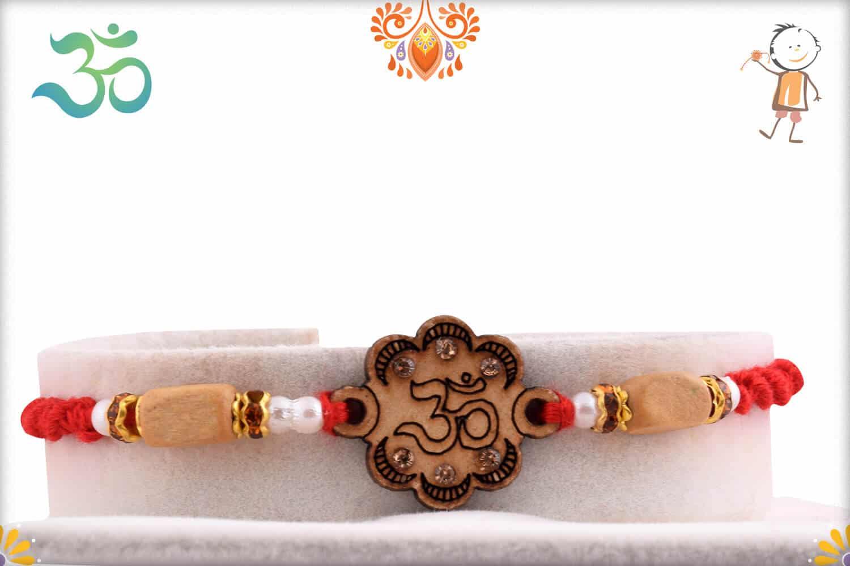 Wood Engraved OM Sandalwood Diamond Rakhi   Send Rakhi Gifts Online 1