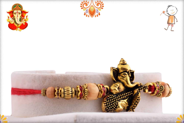 Beautiful Ganeshji with Veena Rakhi | Send Rakhi Gifts Online 2