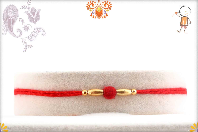 Delicate Red Velvet Bead Rakhi with Golden Beads 1