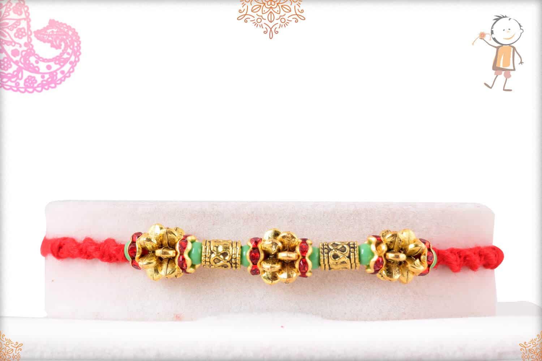 Unique Golden Beads Rakhi with Light Green Beads 1