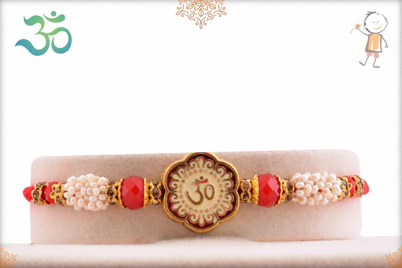 Stunning Meenakari OM Rakhi with Pearls and Red Beads 1