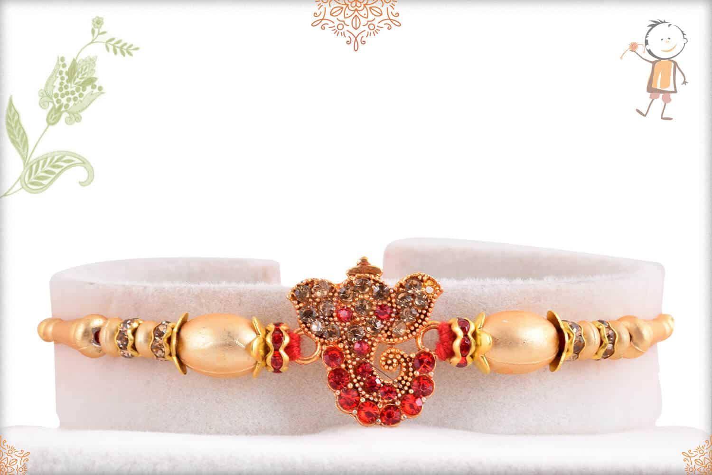 Ganeshji Rakhi with Red Diamonds and Golden Beads 1