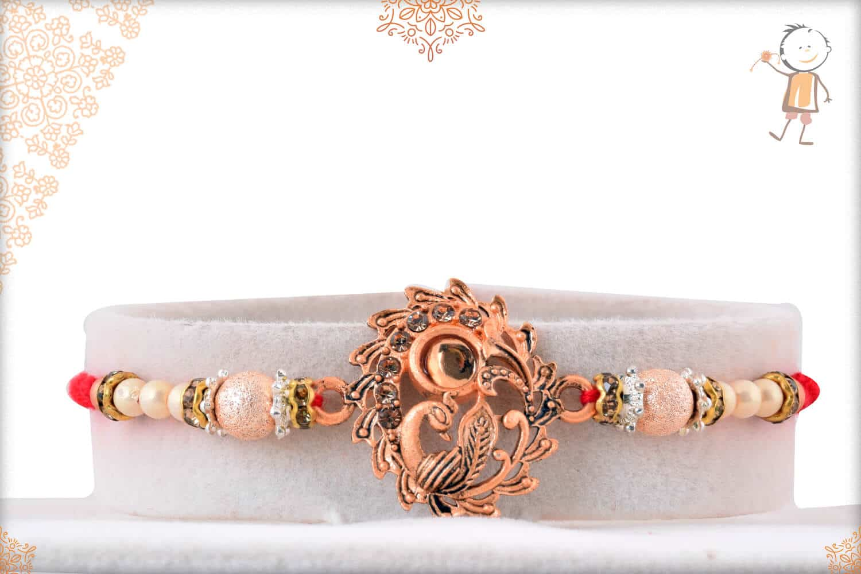 Beautiful Rose Gold Peacock Rakhi with Beads 1