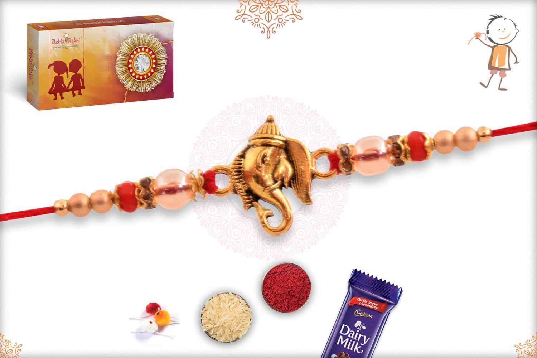 Golden Ganesh Rakhi with Red Beads 2