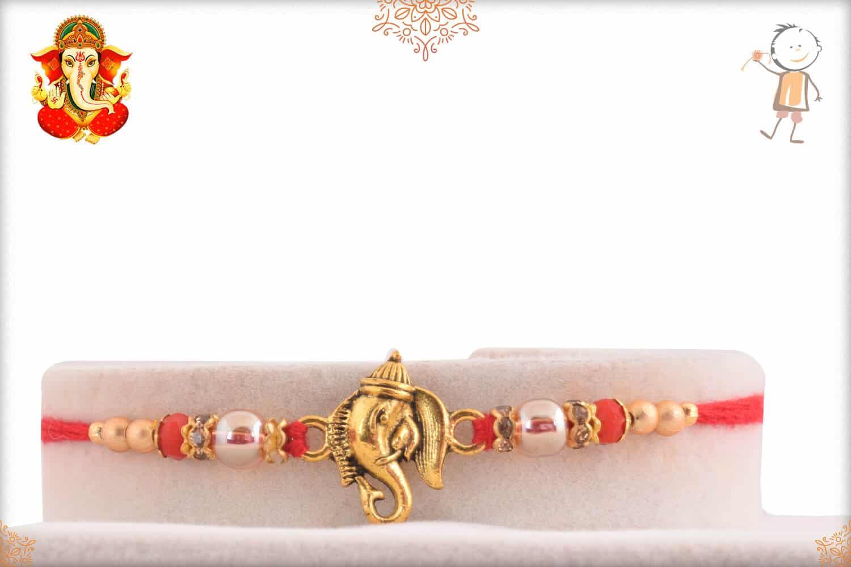 Golden Ganesh Rakhi with Red Beads 1
