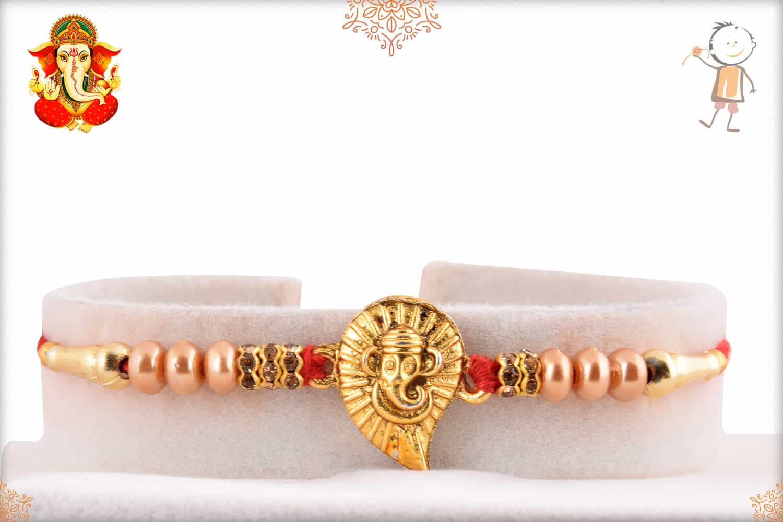 Golden Ganeshji with Pearls Rakhi 1