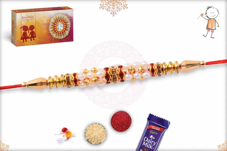 Delicate Golden Rakhi with Red Diamonds 2