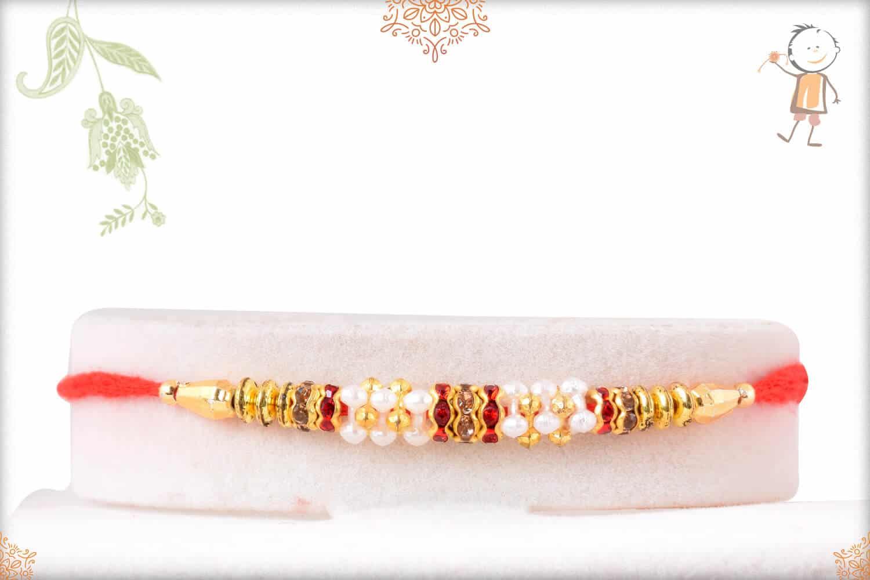 Delicate Golden Rakhi with Red Diamonds 1