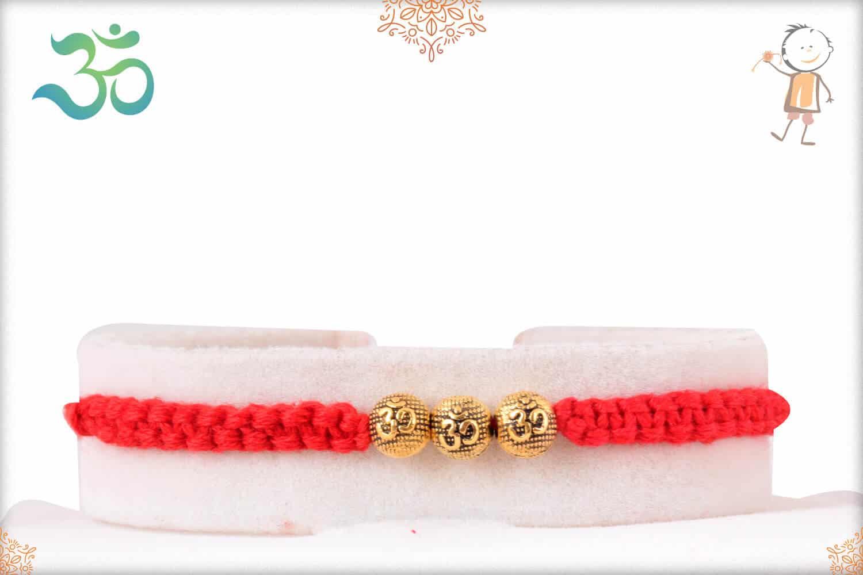 Uniquely Knotted Golden OM Bead Rakhi 1