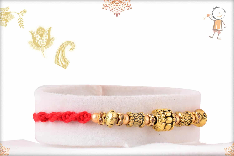 Antique Golden Bead Rakhi 2