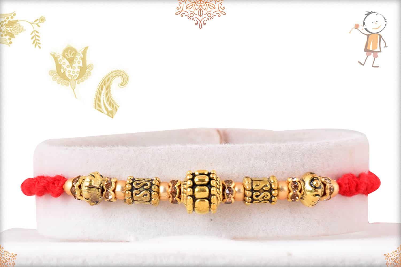 Antique Golden Bead Rakhi 1