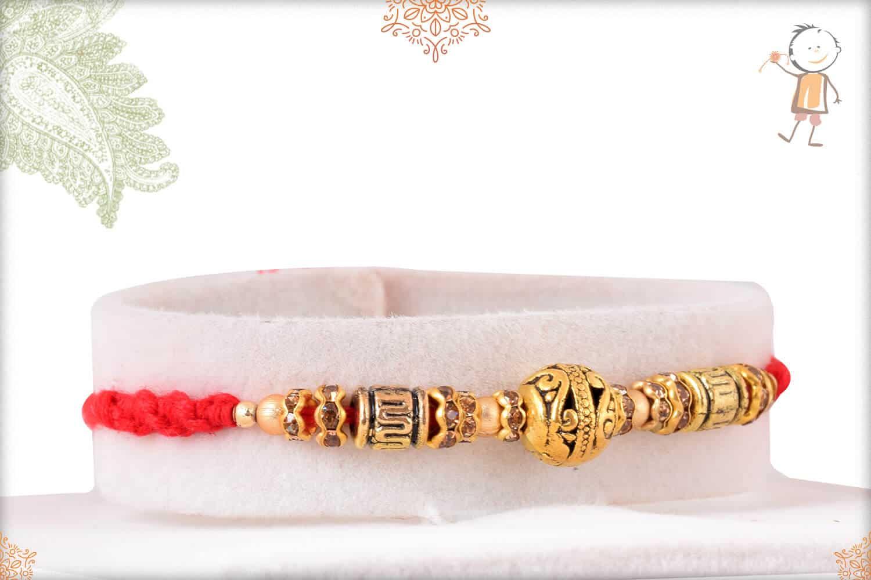 Antique Golden Bead Rakhi with Diamond Rings 2