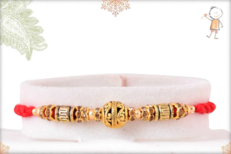 Antique Golden Bead Rakhi with Diamond Rings 1