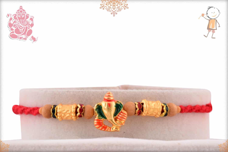 Golden Ganesh Rakhi with Sandalwood Beads 1