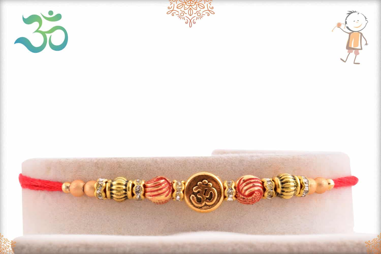 Delicate OM Rakhi with Beads 1