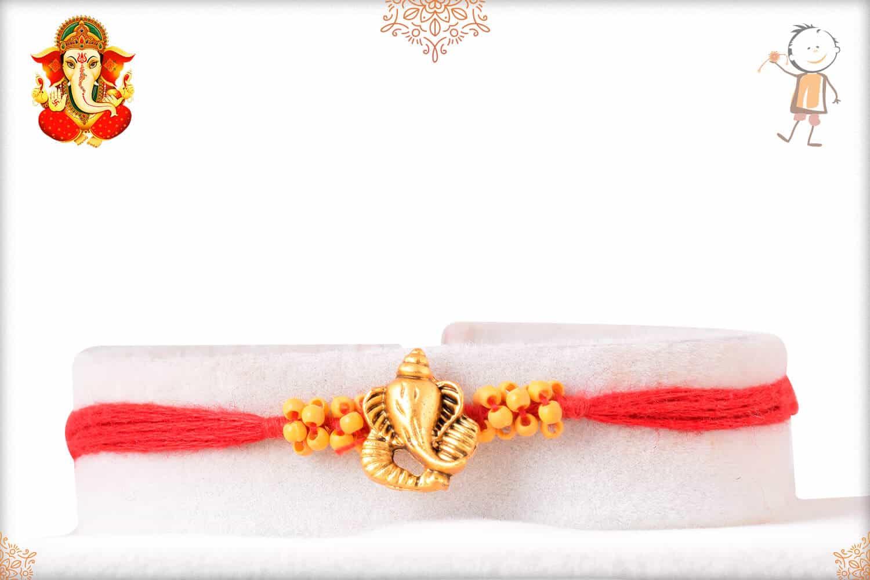 Golden Ganeshji Rakhi with Uniquely Knotted Beads 1