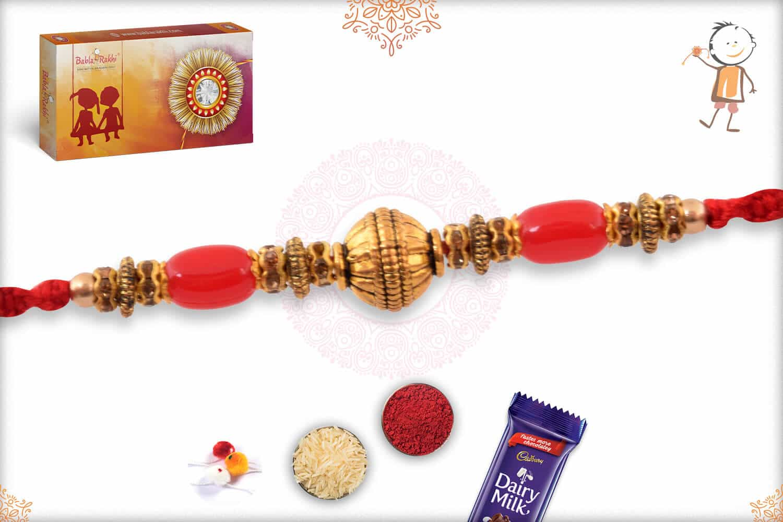 Golden Bead Rakhi with Red Beads and Diamonds 2