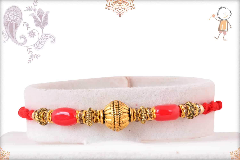 Golden Bead Rakhi with Red Beads and Diamonds 1