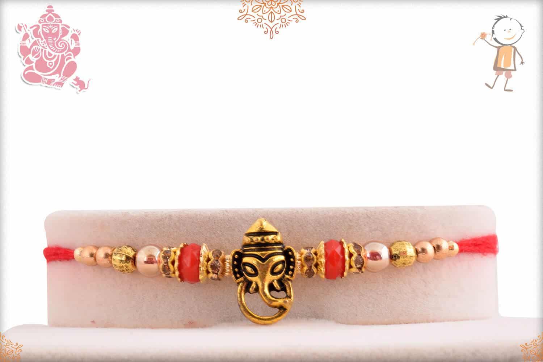 Divine Ganesh Rakhi with Red Beads 1
