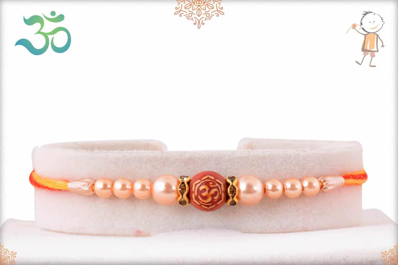 Om with Rose Gold Pearl Rakhi 1