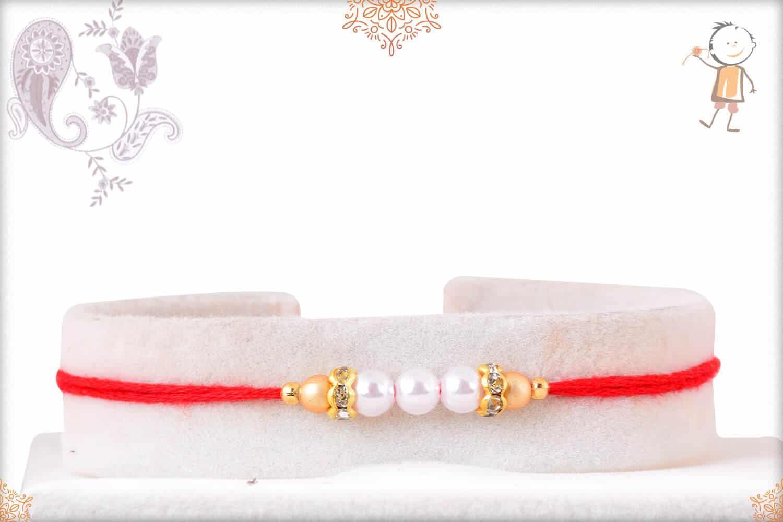 Delicate Pearl with Diamond Rakhi 1