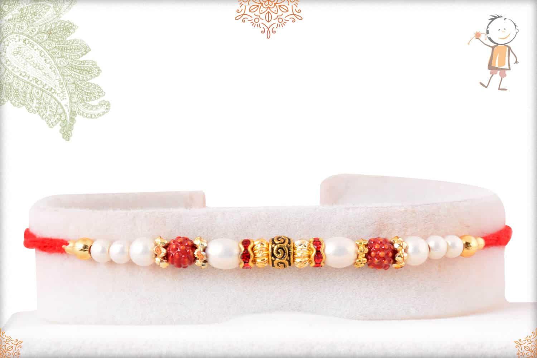 Elegant Pearl Rakhi with Golden Beads 1