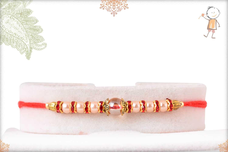 Stunning Pearl Rakhi with Red Diamonds 1