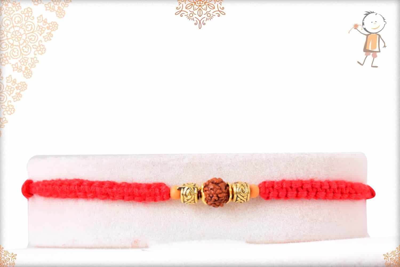Uniquely Knotted Single Rudraksh Rakhi with Designer Golden Beads 1
