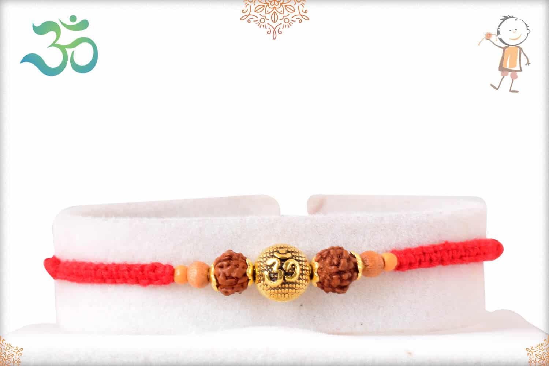 Uniquely Knotted Golden OM Bead Rudraksh Rakhi 1