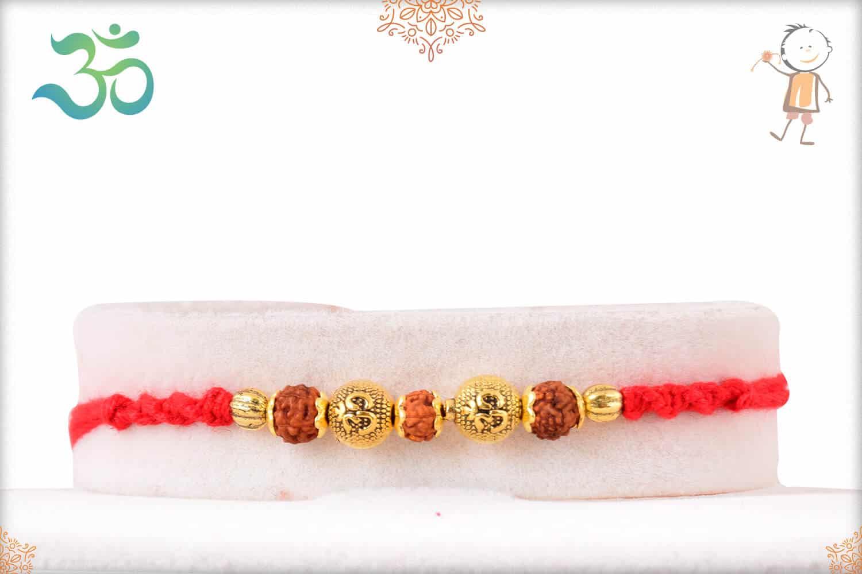 Designer Golden OM Bead with Rudraksh Rakhi 1