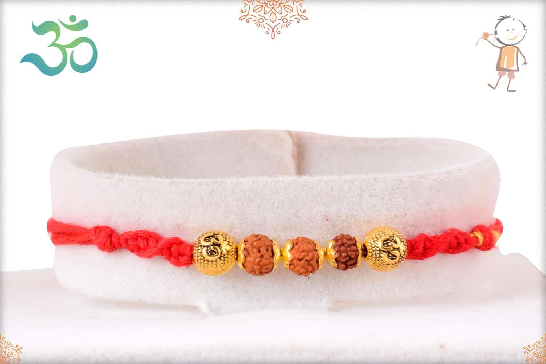 Handcrafted Rudraksh Rakhi with Golden OM Beads 1