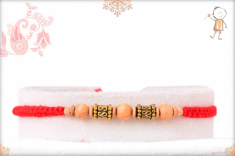 Handcrafted Sandalwood Bead Rakhi with Designer Golden Beads 1