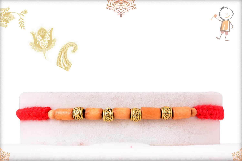 Delicate Sandalwood Beads Rakhi with Designer Golden Beads 1