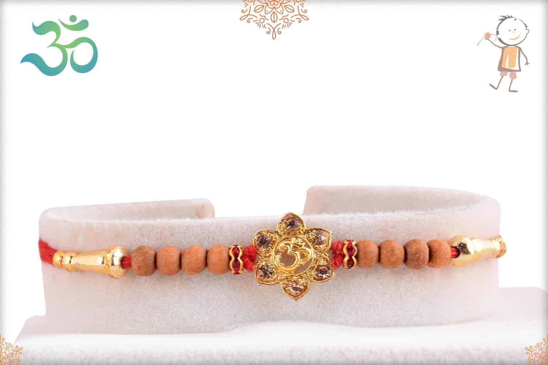 Beautiful OM Rakhi with Sandalwood Beads 1