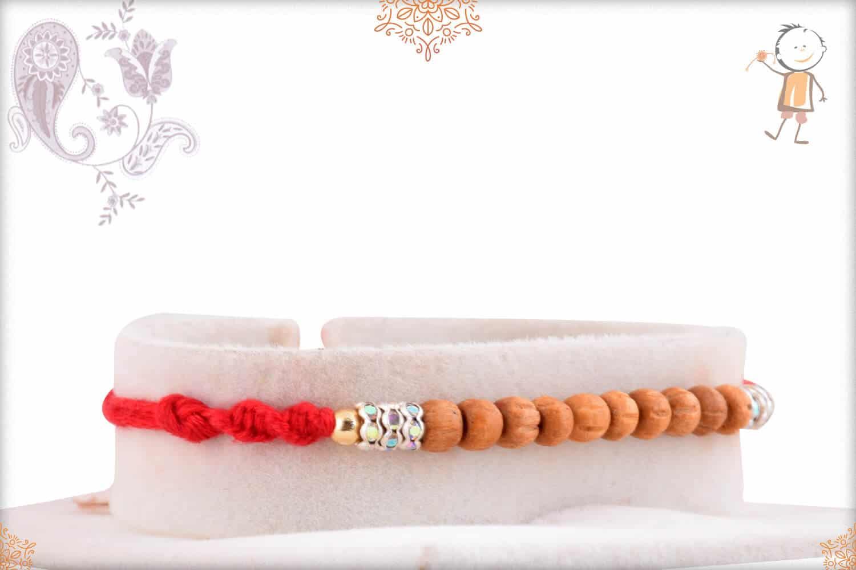 Delicate Sandalwood Beads Rakhi with Diamonds 2