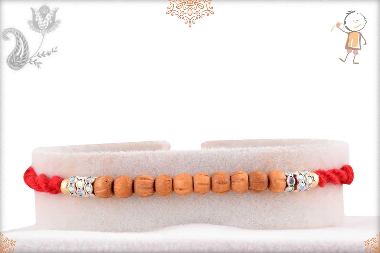 Delicate Sandalwood Beads Rakhi with Diamonds 1
