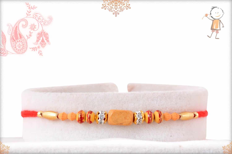Traditional Sandalwood Bead Rakhi with Diamonds 1