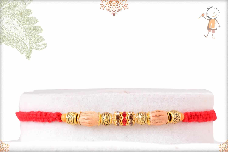 Uniquely Knotted Sandalwood Diamond Rakhi with Golden Beads 1
