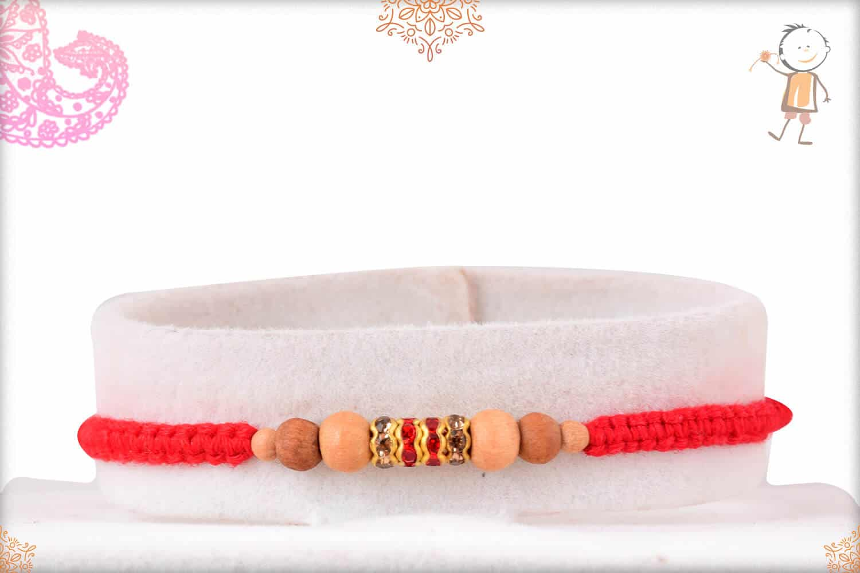 Uniquely Knotted Sandalwood Bead Rakhi with Red Diamonds 1