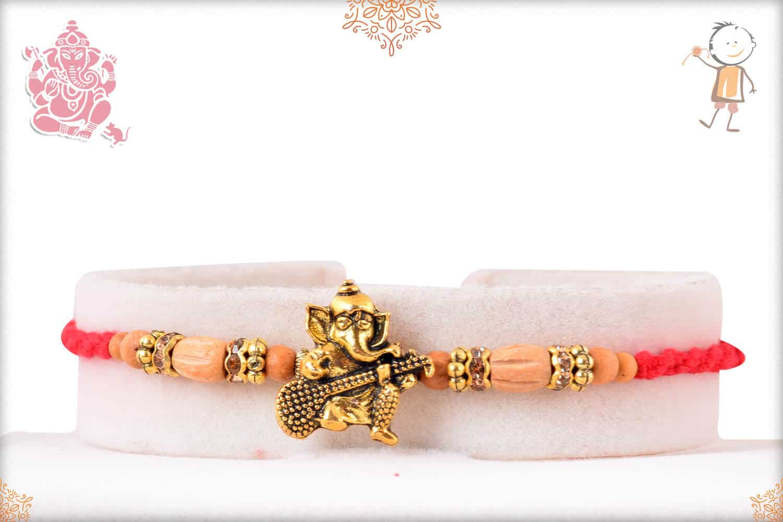 Ganesh Sandalwood Diamond Rakhi 1