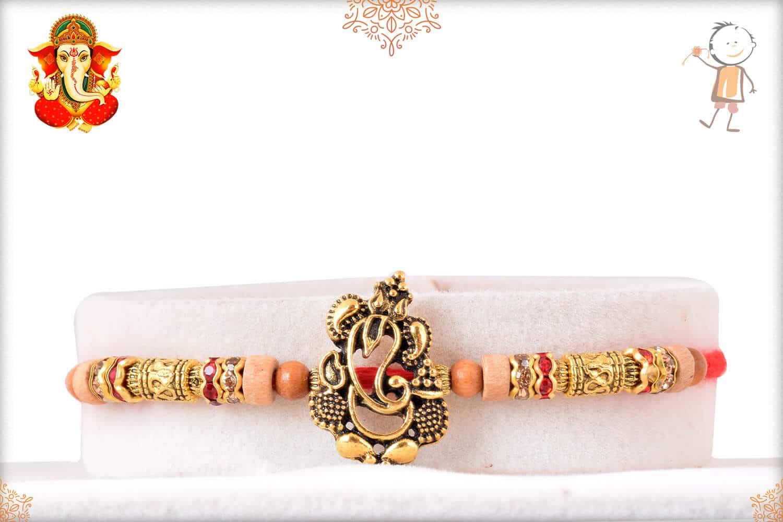 Ganesh Sandalwood Diamond Rakhi with Golden Beads 1