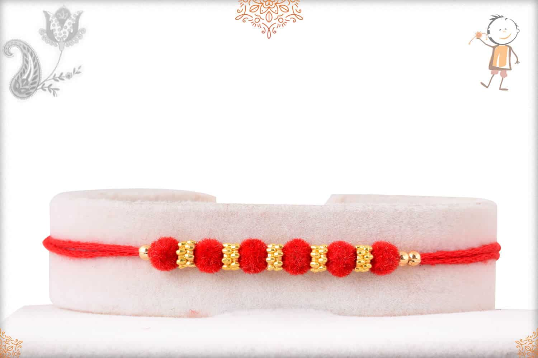 Delicate Red Velvet Bead Rakhi with Golden Rings 1